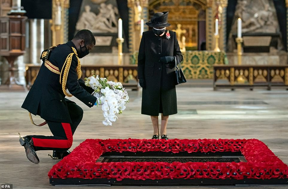 With respect: The Queen's Mare, Lieutenant Colonel Nana Kofi Tomasi-Ankra, lays a bouquet of flowers on the grave of the unknown warrior on behalf of the Queen during a ceremony in Westminster Abbey