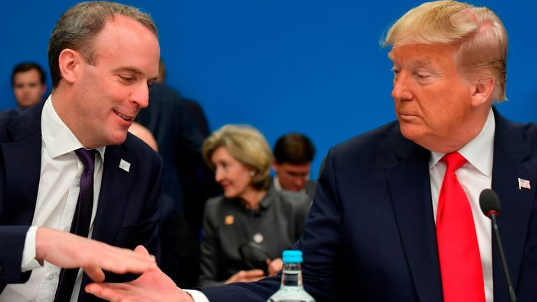 British Foreign Secretary Dominic Raab (left) shakes hands with US President Donald Trump at the start of the plenary session of the NATO Summit at the Grove Hotel in Watford, northeast London, December 4, 2019 (Photo by Tobias Tobias) Schwarz / AFP (Photo by Tobias Schwarz / Press Agency) French via Getty Images)
