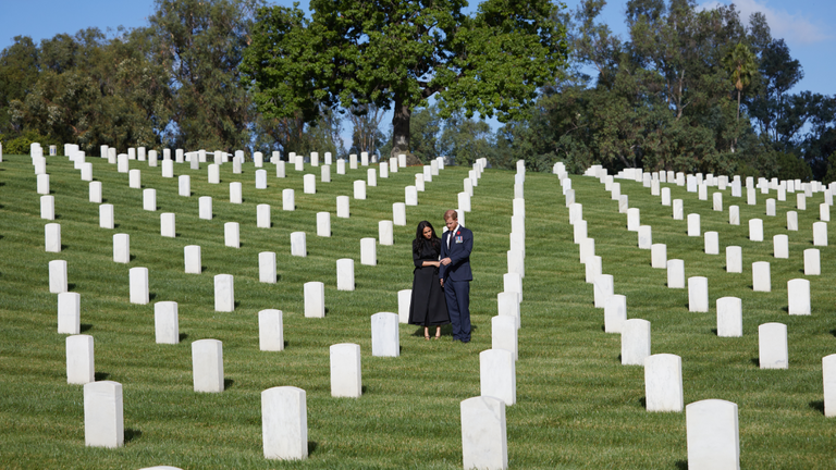 The Duke and Duchess of Sussex pay their respects at Los Angeles National Cemetery in commemoration Sunday. Pic: Lee Morgan