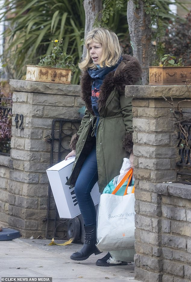 On a mission: Kate appeared assertively carrying her belongings in the waiting car