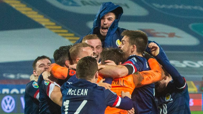 Scottish players celebrate after saving David Marshall who secures a penalty shootout during the UEFA Euro 2020 qualifiers between Serbia and Scotland in Belgrade.