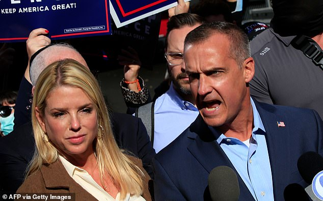 Trump campaign advisor, Corey Lewandowski, with former Florida attorney general Pam Bondi (left), speaks outside the Pennsylvania Convention Center in Philadelphia. The Trump campaign has attacked the state's mail-order voting system and leveled allegations of fraud