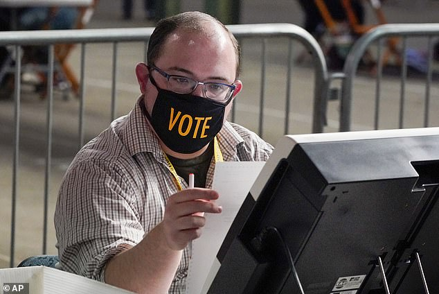 Poll workers are seen in Pittsburgh, Pennsylvania, counting votes on November 6