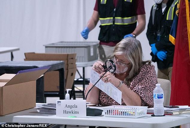 Ballot counters and North Carolina monitors continued counting absentee votes
