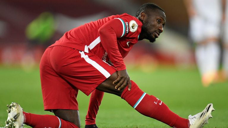 Guinean Liverpool midfielder Naby Keita leaves the stadium injured during the Premier League soccer match between Liverpool and Leicester City at Anfield in Liverpool, northwest England, on November 22, 2020