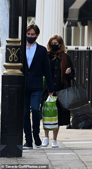 The couple, who are currently staying at Beatrice's apartment at St. James's Palace, carried three shopping bags loaded along the sidewalk.