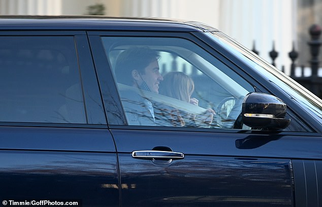 The couple, who had secretly married in Windsor in July during the lockdown, were earlier seen picking up groceries at the London branch of supermarket with Edo's son Wolfie, from his previous relationship with American architect Dara Huang, in September.  Pictured is driving away today