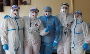 Medical specialists pose for a photo in a hospital for patients with coronavirus disease in Kiev Doctors and medical specialists wearing personal protective equipment pose for a photo in a hospital for patients infected with coronavirus, Kiev, Ukraine, November 25, 2020.