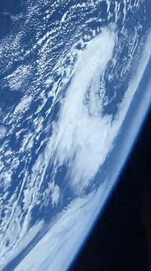The short clip, which was shared on Twitter, is only a few seconds long but shows the curve of our planet, the amazing blue sky and clouds of objects dotted in the atmosphere.