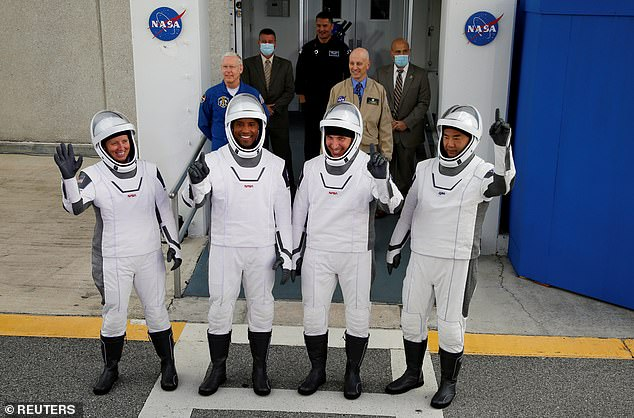 Glover made the 240-mile flight with his captain Michael Hopkins and fellow astronauts Shannon Walker and Soichi Noguchi of the Japanese space agency JAXA