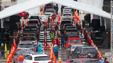 Vehicles line up this month at the Coronavirus Test Center in Miami Gardens, Florida.