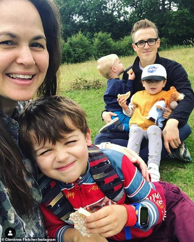 Family: Giovanna explained how the hit song was written after Tom had no gift for her (pictured with their children Buzz, Six, Buddy, Four, and Max, Two)