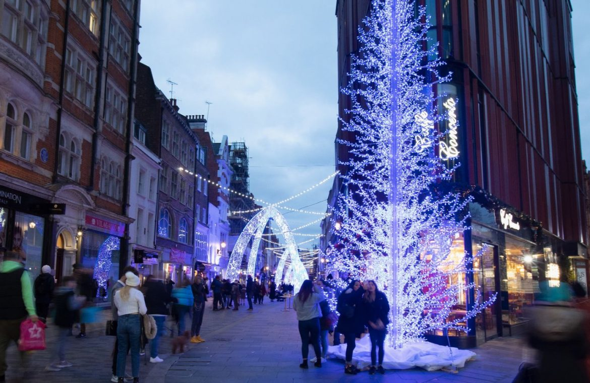 LONDON, ENGLAND - NOVEMBER 21: A view of Blue Arch Christmas Illuminations and busy crowds of people in South Molton Street on November 21, 2020 in London, England. (Photo by Jo Hale/Getty Images)