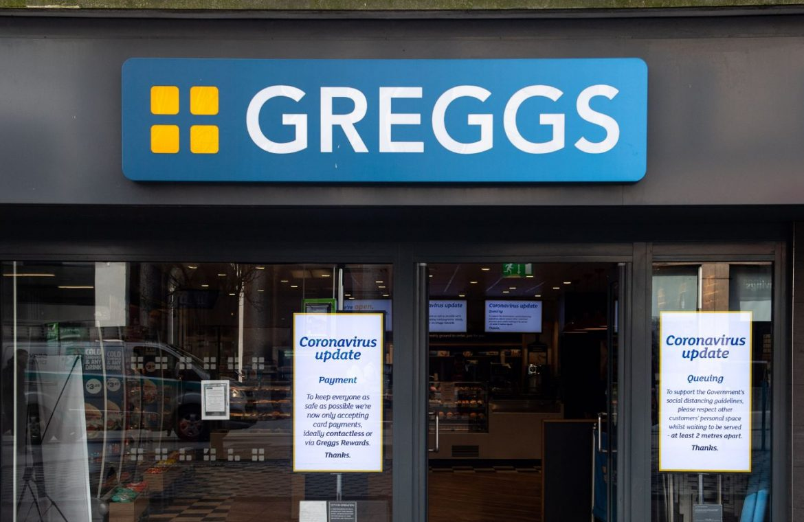 CARDIFF, UNITED KINGDOM - MARCH 23: Signs in the window of a Greggs store with queueing and payment policies on March 23, 2020 in Cardiff, United Kingdom. Coronavirus (COVID-19) pandemic has spread to at least 182 countries, claiming over 10,000 lives and infecting hundreds of thousands more. (Photo by Polly Thomas/Getty Images)