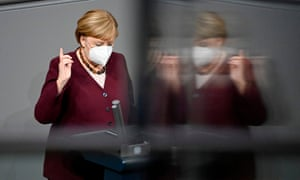 German Chancellor Angela Merkel wears a face mask before giving a speech during a session in the Bundestag