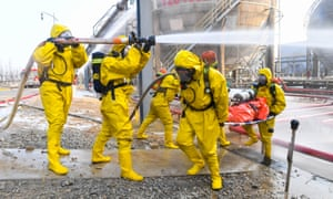 Firefighters participate in an emergency training against winter chemical hazards and accidents in Wuhai, Northern China's Inner Mongolia Autonomous Region, November 25, 2020