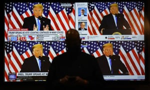 A live broadcast of Donald Trump speaking from the White House is shown on screens at the Election Night party in Las Vegas on November 3.