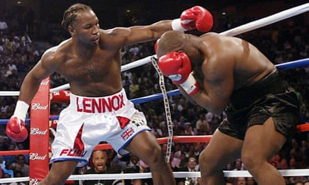 Lennox Lewis lines up a punch against Mike Tyson at the 2002 World Heavyweight Championship in Memphis.
