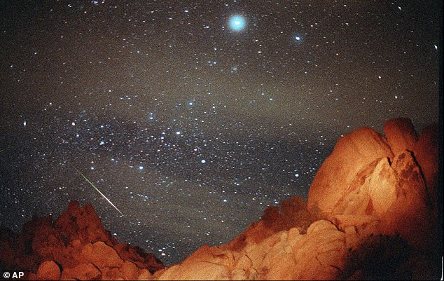 The Leonid meteor shower is set to be shown on an out-of-this-world screen next week, with one meteor appearing across the sky every five minutes during its zenith. Pictured is the event that appears over Joshua Tree National Park in 1998
