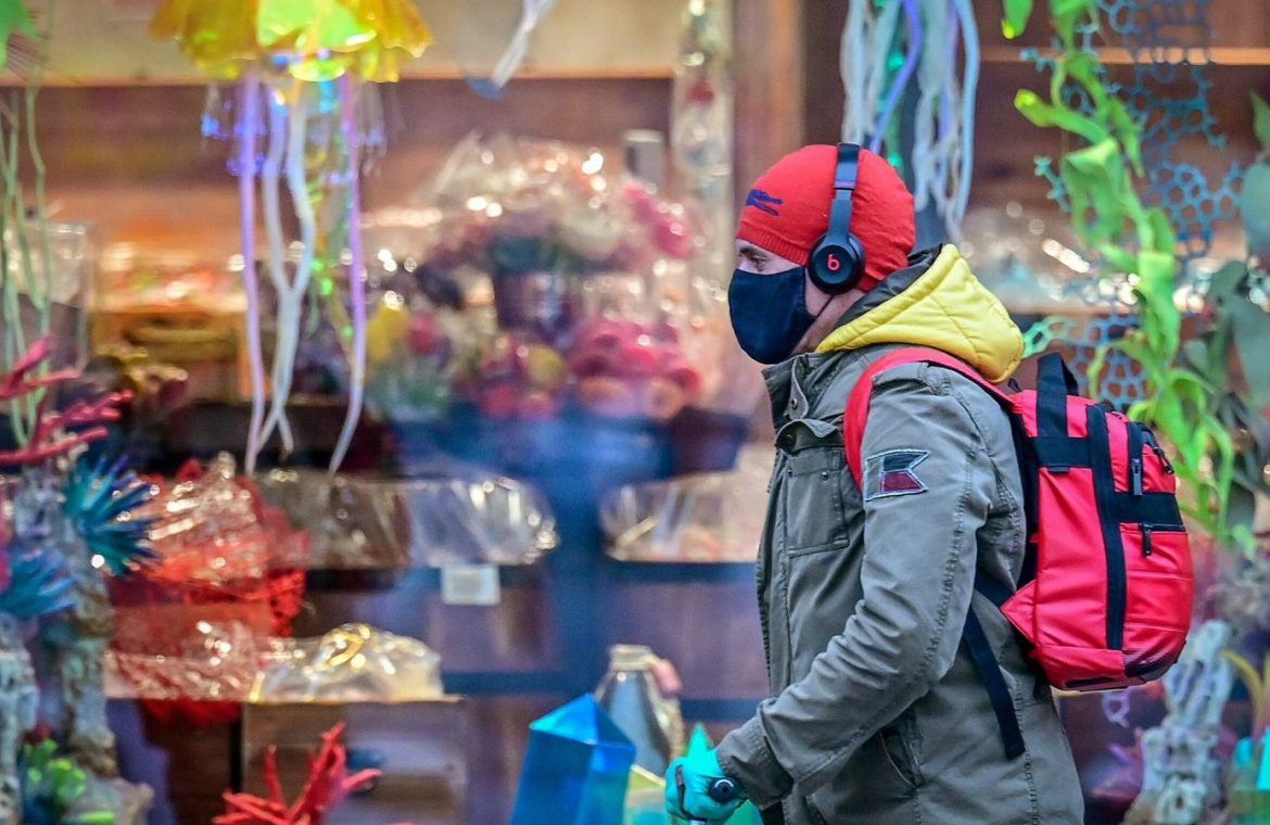 A man wearing a face mask as a measure against the spread of the Covid-19 (novel coronavirus) pandemic rides a scooter in central Moscow on November 8, 2020.