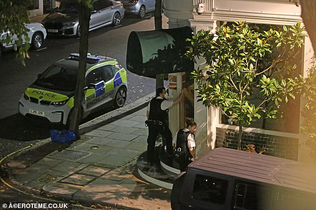 During the night, police officers were filmed outside in the restaurant staring out at the windows trying to open a single metal door