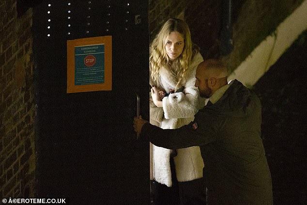 Spotted: Poppy (pictured at the Casa Cruz party on Saturday) wearing the same coat