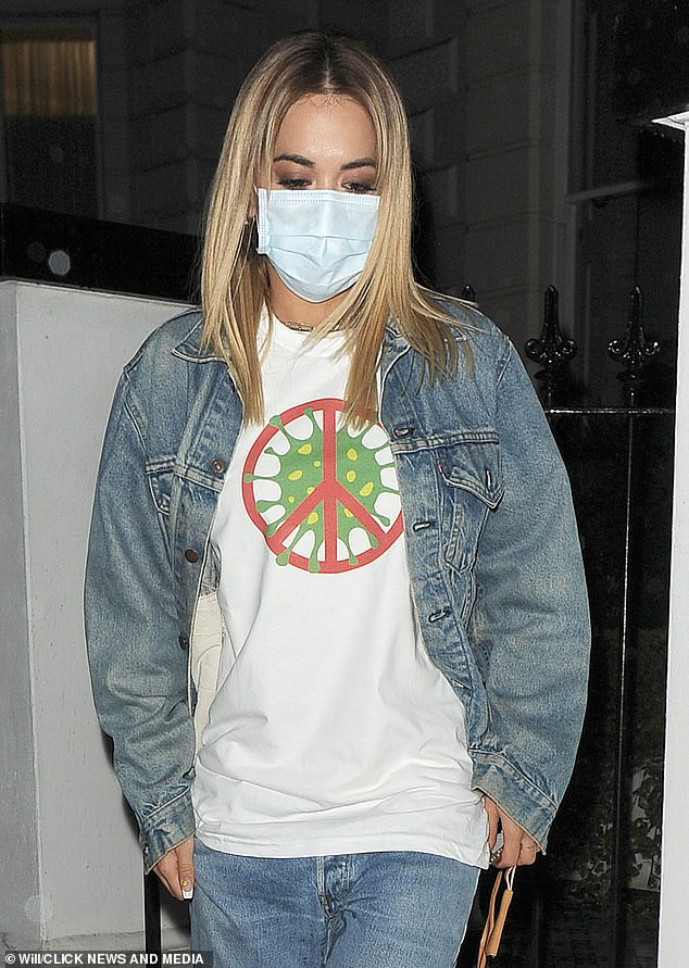At the time ... Rita urged people to `` stop the spread '' of the Coronavirus when she went out wearing a self-designed T-shirt in March.