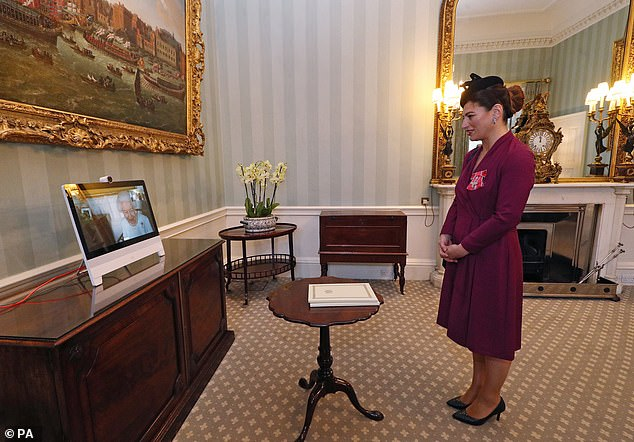 According to tradition, three ambassadors presented their credentials to the king but via a video link, which was organized according to medical advice.  Pictured right: Sophie Katsarava, Ambassador of Georgia, who was at Buckingham Palace, London