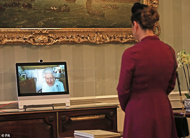 Her Majesty (pictured left talking to Sophie Katsarava), 94, was staying with Prince Philip, 99, at a Berkshire home during the pandemic.