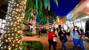 In this file photo taken on November 30, 2020, shoppers are seen at Citadel Outlets in Los Angeles, California.  California Governor Gavin Newsom announced on December 3, 2020 a new statewide ban on gatherings and activities