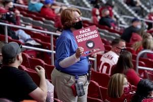 Holds a banner at a football match