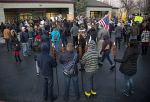 Anti-masks, some carrying tiki torches, protest at central health offices during a special board meeting to decide on mandates for new masks on Friday, Dec. 4, 2020 in Boise, Idaho.