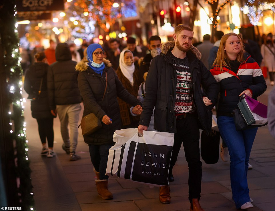 On the first day off since the lockdown ended on December 2, shoppers were photographed carrying bags of merchandise and waiting in lines outside stores, including Primark and Debenhams which will close soon.