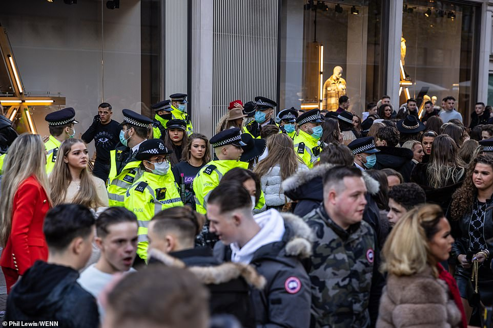 The Metropolitan Police confirmed that officers were called in for reports of a large group attempting to enter a store in southwest London shortly after 1pm, and four men were arrested.