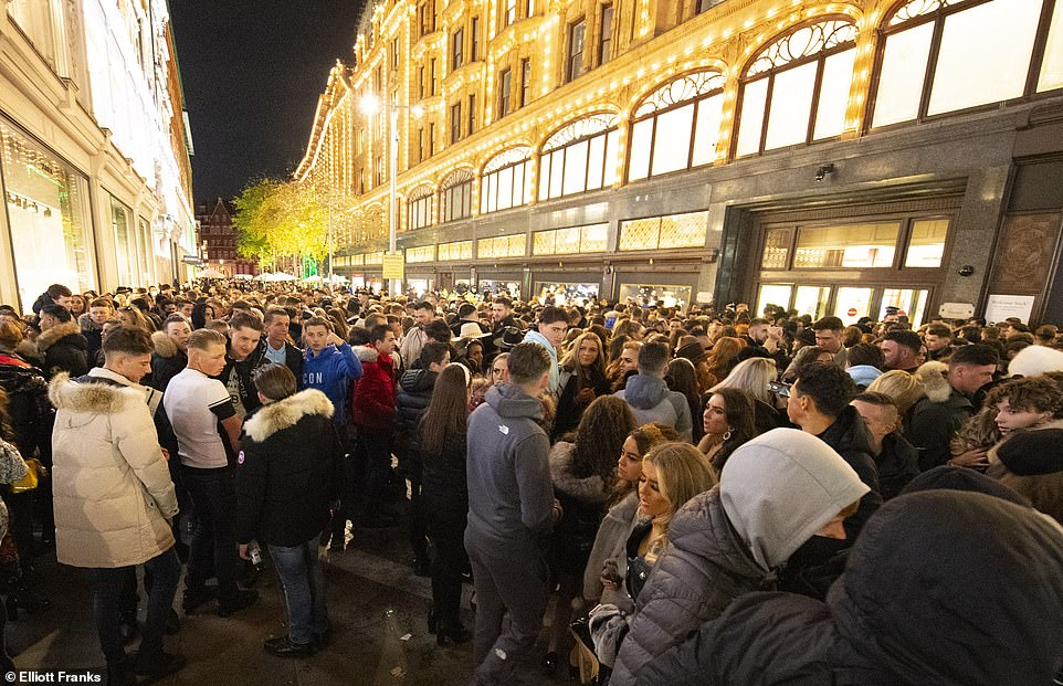 Hundreds of young men tried to enter the luxury department store Harrods in Knightsbridge, London today and crowded together on the streets outside.