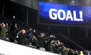 Fans celebrate their first goal