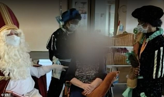 Santa and his aides spoke with residents of the nursing home last week.  His aides wear black face and dress as Zwarte Piet ('Black Pete'), a controversial traditional figure in the Netherlands and parts of Belgium