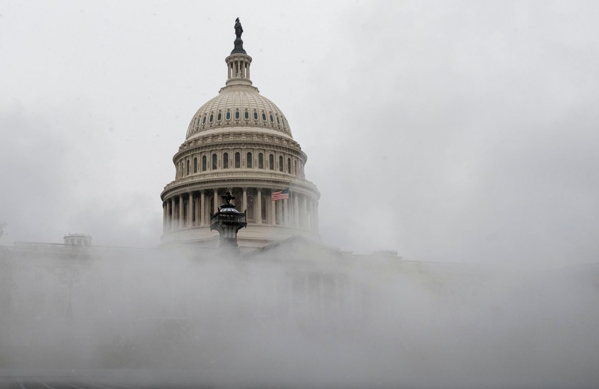 The US Capitol is enveloped with mist on Wednesday as much of the East Coast braces for snow