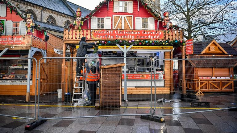 Staff remove Christmas decorations in Cardiff city center