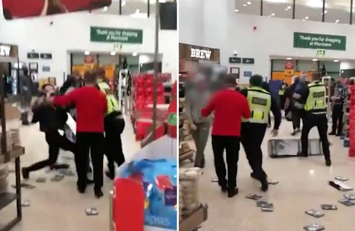 A momentary brawl in the supermarket erupts as Morrisons' company shoppers attack security guards