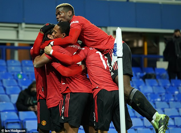 United Mob Cavani players after their team gave the lead at Goodison Park on Wednesday