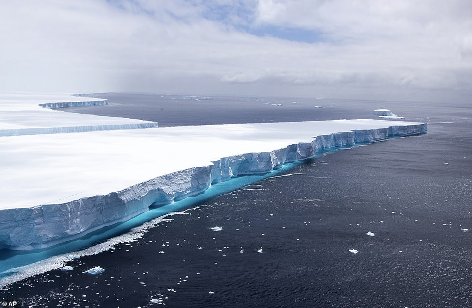 In this recent published photo provided by the Department of Defense, one of the largest recorded icebergs called A68a floats near South Georgia Island in the South Atlantic.