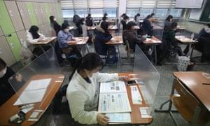 South Korean students take the Scholastic Aptitude Test at a school in Seoul, South Korea.