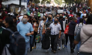 Mexico City shoppers wear masks.