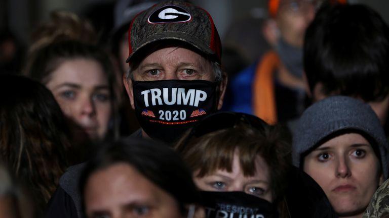 A man wears a Trump 2020 face mask at a rally in Valdosta, Georgia