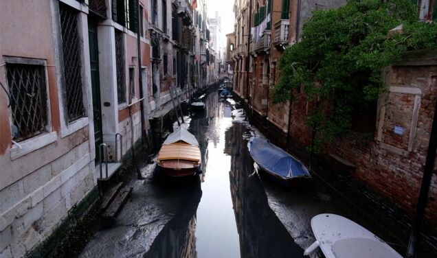 Lower rather than high water.  The canals of Venice are dry
