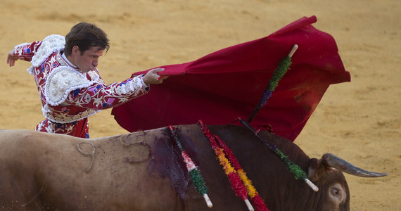 Spain: a mass celebration in Madrid.  Bullfighting among the attractions