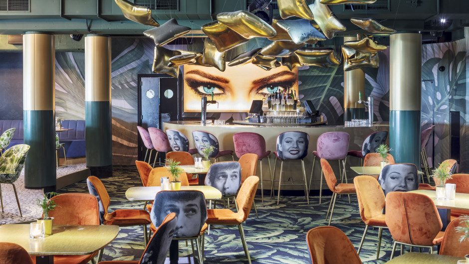 Cinema and Surrealism dominate the interiors of this club