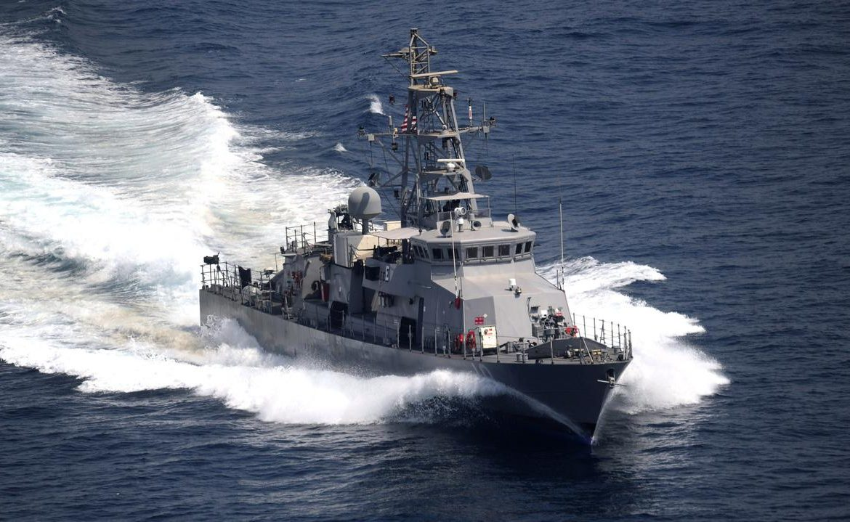 United States - Iran.  An American ship fired warning shots in the Persian Gulf