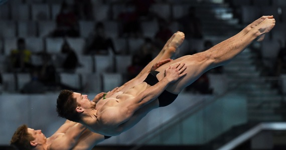 Me swimming.  Rzieszotek is eighth in jumping off a 3-meter launch pad